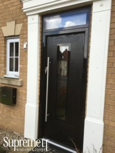 black door with rectangular window on the center